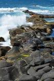 Sea waves breaking on the rocks Stock Photos