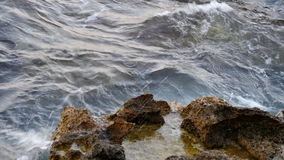 Sea waves breaking on the rocks stock video footage