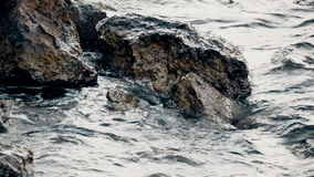 Sea waves breaking on the rocks stock footage