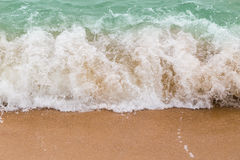 Sea waves breaking on sandy beach as background resources Stock Photos