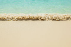 Sea waves breaking on sandy beach Royalty Free Stock Images