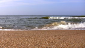 Sea waves breaking on sandy beach stock video footage