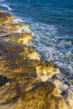 Sea waves breaking on the shore rocks Stock Image