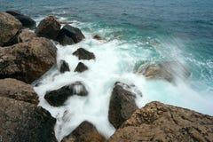 Sea waves breaking on a stony shore Royalty Free Stock Photography