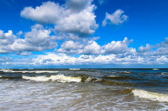 Sea waves and clouds on a blue sky. Baltic sea with waves and clouds on a blue sky. Picture taken in Jastrzebia Gora in Poland Stock Photography
