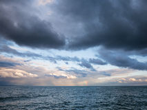 Sea with waves and clouds in the sky Stock Photos