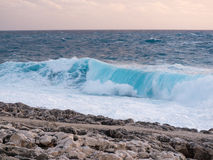 Sea with waves and clouds in the sky Stock Photography