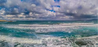 SEA, WAVES & CLOUDY SKY -CRETE ISLAND-INTRALEX 2016. WAVES COMING OUT WITH A CLOUDY SKY AS BACKROUND , PANORAMIC IMAGE Royalty Free Stock Photos
