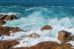 Sea waves coming to the rocks on the shore Royalty Free Stock Photography