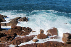 Sea waves coming to the rocks on the shore Royalty Free Stock Photo