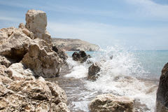 Sea waves crashed on the rocks Stock Images