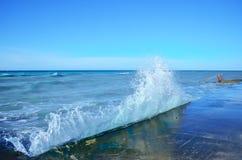Sea waves crashing against the concrete pier Royalty Free Stock Photos