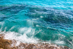 Sea waves crashing against the rocks, view from above. Stock Photos
