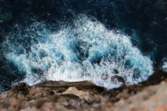 Sea waves crashing against rocks royalty free stock photography