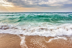 Sea ​​waves Crashing On Sandy Beach Stock Images