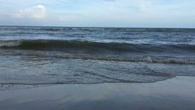 Sea waves crashing over sand beach continuously, cloudy sky. Sea waves crashing over sand beach continuously, cloudy sky, Hua Hin Thailand stock footage