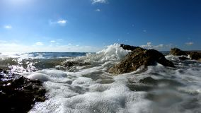 Sea waves crushing on a rocky beach stock video footage