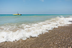 Sea waves with defocused motor boat Stock Photography