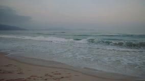 Sea waves fishing boats Mountain View. deserted beach. At Nha Trang. Vietnam stock video footage