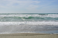Sea waves with foam at the shore of national park Cabo de Gata. Near Almeria, Andalusia, Spain Royalty Free Stock Image