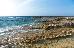 Sea waves with foam on the stony shore Royalty Free Stock Photography