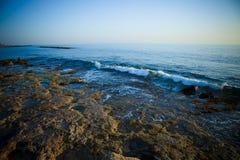 Sea waves with foam on the stony shore. Toned Royalty Free Stock Photos