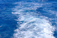 Sea. Waves in the sea foamy trail Royalty Free Stock Photo