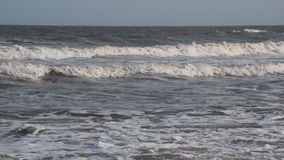 Sea waves go to the shore. Sea waves go to the shore stock footage