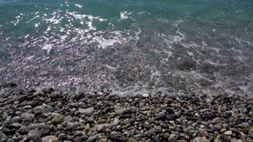 Sea waves on a gravel beach. Pure clear water stock video