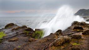 Sea waves hitting rock, spindrift Royalty Free Stock Image