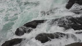 Sea waves hit the stones stock video footage