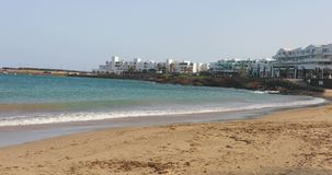 Sea waves hitting the beach in Costa Teguise, Lanzarote stock video footage