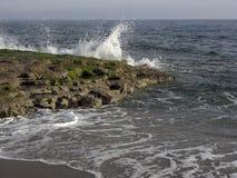 Sea waves hitting rocky shore Royalty Free Stock Photography