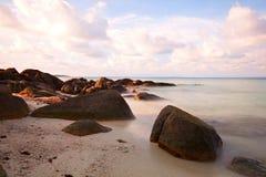 Sea waves lash line impact rock Royalty Free Stock Image