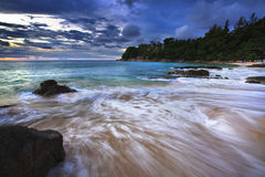 Sea waves lash line impact rock on the beach. Laemsing beach Located only 20 minutes north of Patong, Laem Sing Beach, Phuket is an ideal place to unwind. The Stock Images