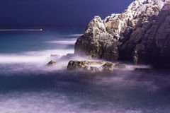 Sea waves lash line impact rock on the beach in night Royalty Free Stock Photography