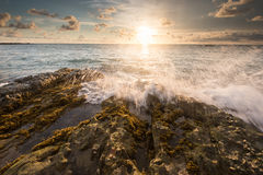 Sea waves lash line impact rock on the beach Stock Photography