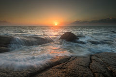 Sea waves lash line impact rock on the beach Royalty Free Stock Photo