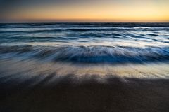 Sea waves in motion in sunset, Ocean Waves Washing. Long exposure of sea waves motion, sunset Stock Image