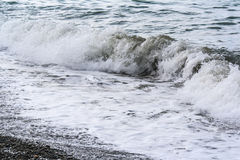 Sea waves on a pebbly shore Stock Photo