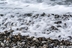 Sea waves on a pebbly shore Royalty Free Stock Images