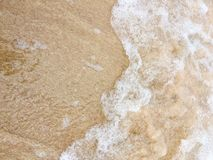 Sea waves reaching lapping to shore Royalty Free Stock Photo