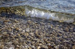 Sea waves, restless sea level, waves breaking on rocks stock photography