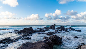 Sea Waves With Rock Formation Under the Blue Sky Stock Image