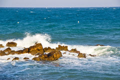 Sea waves and rocks. A shot on the beach of Antibes, French Riviera royalty free stock photography
