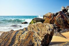 Sea waves and rocks on the beach in Malgrat de Mar, Spain. Royalty Free Stock Images