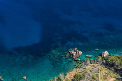 Sea waves and rocks. On the steep west coast of Mallorca Royalty Free Stock Image