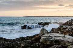 Sea waves and rocks at sunset. Seascape in Mallorca Royalty Free Stock Photo