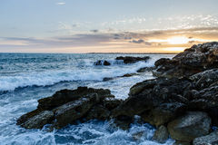 Sea waves and rocks at sunset. Seascape in Mallorca Royalty Free Stock Image