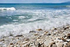 Sea and rocky beach Stock Photos